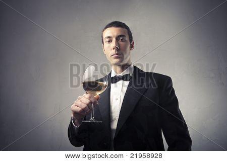 Handsome elegant man holding a glass of wine