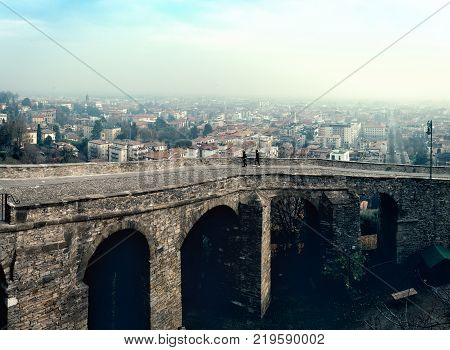 Ruins of old bridge at old town Cita Alta of Bergamo town in Italy