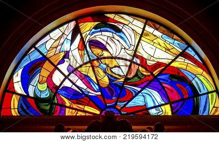 FATIMA, PORTUGAL - SEPTEMBER 17, 2017 Mary Dove Stained Glass Basilica of Lady of Rosary Fatima Portugal. Church created on site where three Portuguese Shepherd children saw Virgin Mary of the Rosary. Basilica created in 1953.