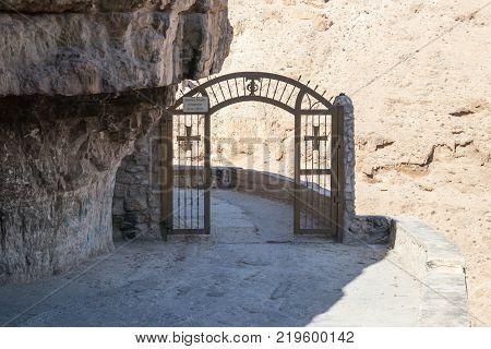 Near Mitzpe Yeriho Israel November 25 2017 : Gates on the mountain road - entrance to the monastery of St. George Hosevit (Mar Jaris) standing near Mitzpe Yeriho in Israel