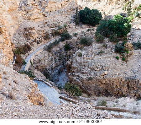 The bed of the dried-up river at the foot of the monastery of St. George Hosevit (Mar Jaris) in Wadi Kelt near Mitzpe Yeriho in Israel