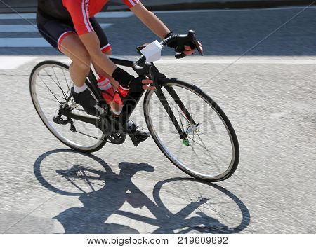 Fast Cyclist Over Her Bike During The Curve