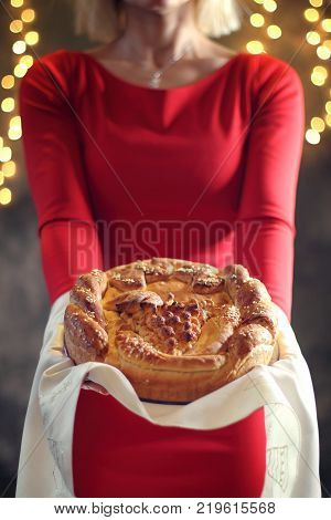 A girl offers ritual bread. Christmas concept