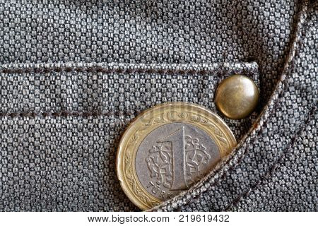 Turkish Coin With A Denomination Of 1 Lira In The Pocket Of Brown Denim Jeans
