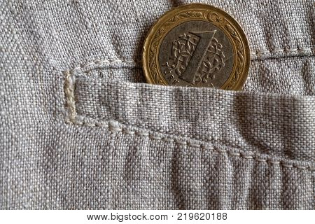 Turkish Coin With A Denomination Of One Lira In The Pocket Of Worn Linen Pants