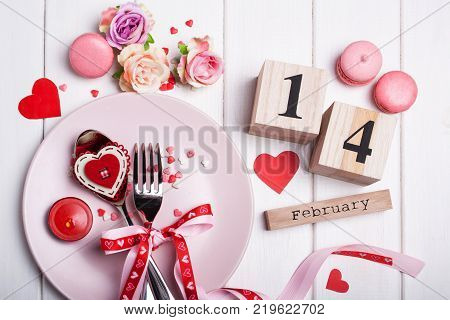 Romantic dinner for Valentine's Day with hearts and calendar
