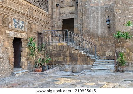 Cairo, Egypt - November 25, 2017: Courtyard of Prince Taz palace with staircase and entrance leading to the first floor located in Old Cairo Egypt