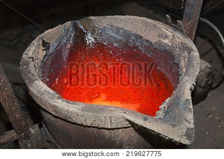 Molten metal. Left over material from the steel manufacturing process is poured away on at a Steel Foundry poster