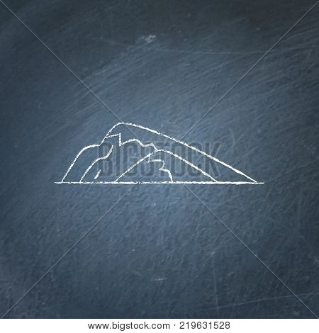 Sloping hill icon on chalkboard. Low mountain symbol - chalk drawing on blackboard.