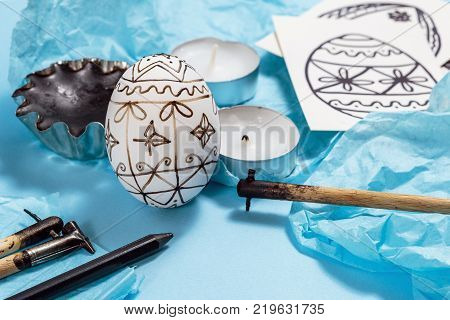 Preparation for Easter holiday. Tools for decorating Paschal eggs Pysankas with wax-resist dyeing technique traditional for Eastern European countries.