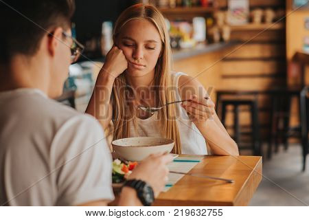 Portrait of woman with no appetite. He has tired, bad mood and sleepy