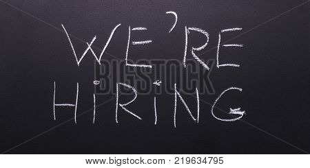 We're hiring is the concept of a poster for hiring staff.