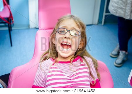 Preschooler Child Is At Dentist Office