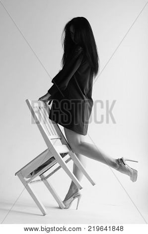 Beauty portrait of ginger woman with long hair posing