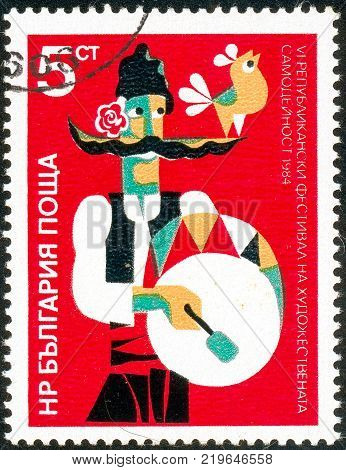 Ukraine - circa 2017: A postage stamp printed in Bulgaria shows drawing man in national clothes. 6th Amateur Art Festival. Circa 1984