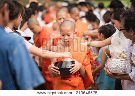 Lampang, Thailand - July 9, 2017: Unidentified People Offer Food To Monks In Devo Tradition On July