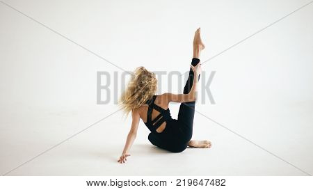 Modern beautiful teenage girl dancer dancing contemporary on white background