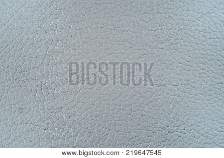 Artificial leather. Fine relief texture. Background or backdrop of blue or gray leatherette.