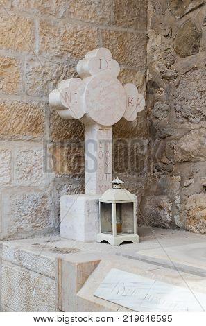 Near Mitzpe Yeriho Israel November 25 2017 : Marble cross in the courtyard of the monastery of St. George Hosevit (Mar Jaris) in Wadi Kelt near Mitzpe Yeriho in Israel