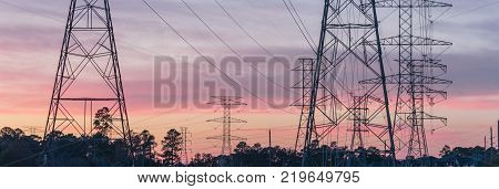 Industrial Background Group Silhouette Of Transmission Towers Sunset