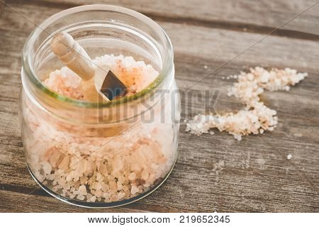 himalayan salt coarse with wooden background letter S