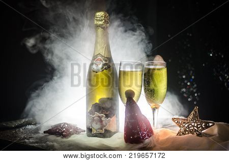 New Year Eve Celebration Background With Pair Of Flutes And Bottle Of Champagne With Christmas Attri