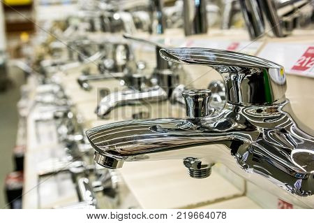 Close up several new water taps in supermarket