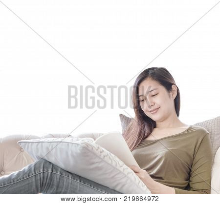 Closeup woman sitting on sofa for reading a book in free time in the afternoon isolated on white background relax time of asian woman concept with plipping path