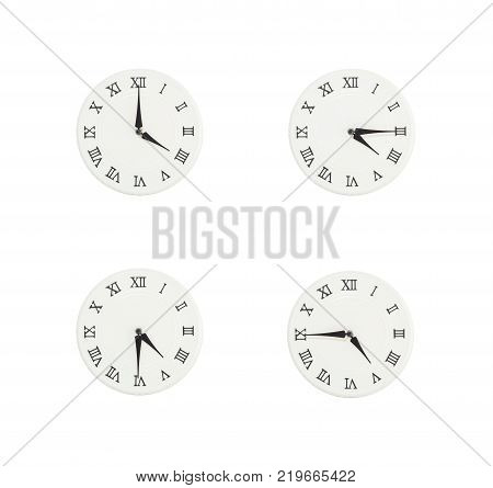Closeup group of white clock with shadow for decorate show the time in 4 4:15 4:30 4:45 p.m. isolated on white background beautiful 4 wall clock picture in different time