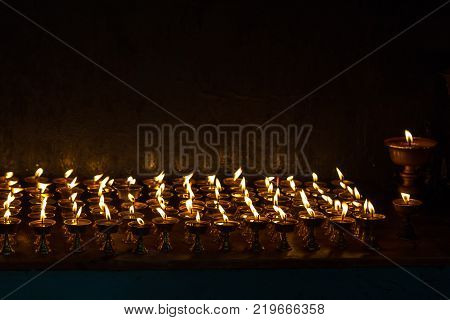 Candles in the interior of the temple in Tashi Ling village. Tashi Ling is one of the Tibetan refugee camps in Nepal
