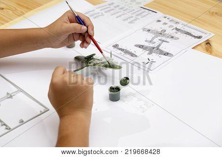 Boy Gluing Plastic Model Kit