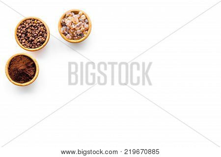 Coffee concept. Roasted beans, ground coffee and sugar on white background top view.