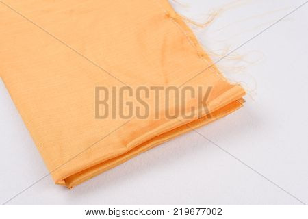 Abstract background luxury silk yellow fabric, drapery, texture, background pattern