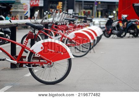 BARCELONA, SPAIN - August, 2014: Vodafone Bicing, public bicycles service at Barcelona. Vodafone Bicing is a bicycle sharing system inaugurated on March 22, 2007.