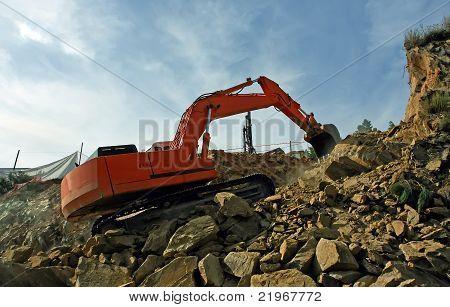 Excavator Crushing Rocks