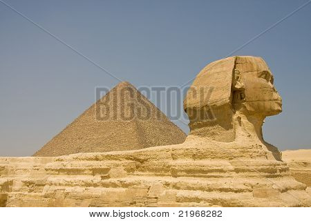 Sphinx in Giza, Egypt with Pyramid of Khufu in the background