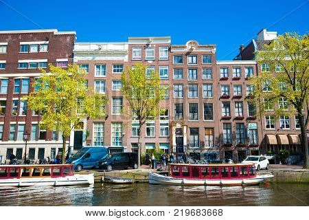 Amsterdam, Netherlands - April 19, 2017: One of the channels in Amsterdam with many boats.