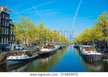 Amsterdam, Netherlands - April 20, 2017: One of the channels in Amsterdam with many boats.