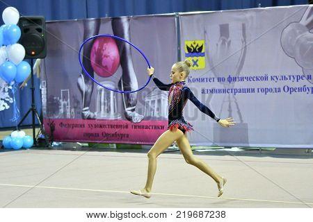 Orenburg, Russia - November 25, 2017 Year: Girl Performs Exercises With Gymnastic Hoop In Rhythmic G