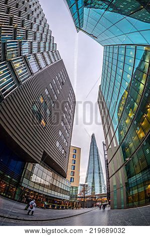 LONDON ENGLAND - NOVEMBER 27 2017: Modern and spectacular office buildings on More London Riversid and The Shard building in bachground.