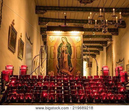 SAN JUAN CAPISTRANO, CALIFORNIA - 1 NOVEMBER 2017: Prayer candles and church interior at San Juan Capistrano in California