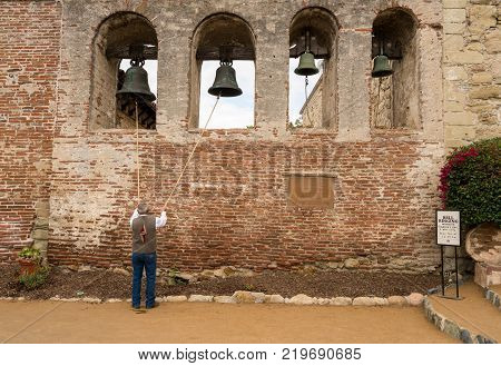 SAN JUAN CAPISTRANO, CALIFORNIA - 1 NOVEMBER 2017: Native american man ringing bells for Founders Day at San Juan Capistrano in California