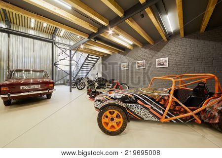 MOSCOW, RUSSIA - OCT 27, 2017: (PR) Racing car based on Lotus Seven and sports motorcycles in garage of DB 527 company producer of russian sports cars.