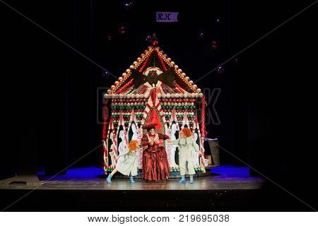 MOSCOW, RUSSIA - OCT 22, 2017: Actors on stage of New Opera Theatre during musical fairytale performance Gingerbread House or Hansel and Gretel.