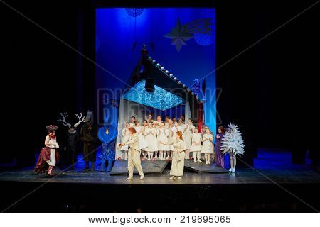 MOSCOW, RUSSIA - OCT 22, 2017: Actors on stage of New Opera Theatre at final of musical fairytale performance Gingerbread House or Hansel and Gretel.
