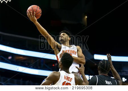 NEWARK, NJ - DEC 9: Florida Gators guard Jalen Hudson (3) goes up for a shot during the game against the Cincinnati Bearcats on December 9, 2017 at the Prudential Center on  Newark, New Jersey.
