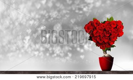 Heart shaped red roses on tree on bokeh hearts background