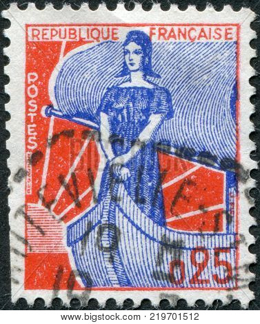 FRANCE - CIRCA 1960: A stamp printed in France depicts Marianne on a sailboat circa 1960