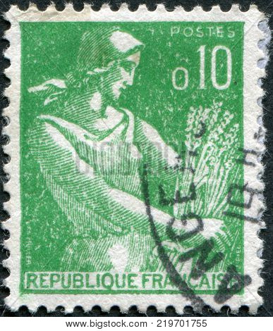 FRANCE - CIRCA 1960: A stamp printed in France shows a Farm Woman circa 1960