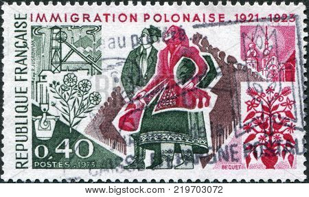 FRANCE - CIRCA 1973: A stamp printed in France devoted to 50th anniversary of Polish immigration into France shows Polish Immigrants circa 1973